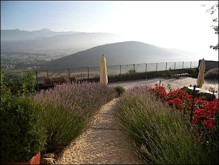 small castle hotels in Italy: Fortress Monastery Santo Spirito outdoor terrace with view of gran sasso d'Italia